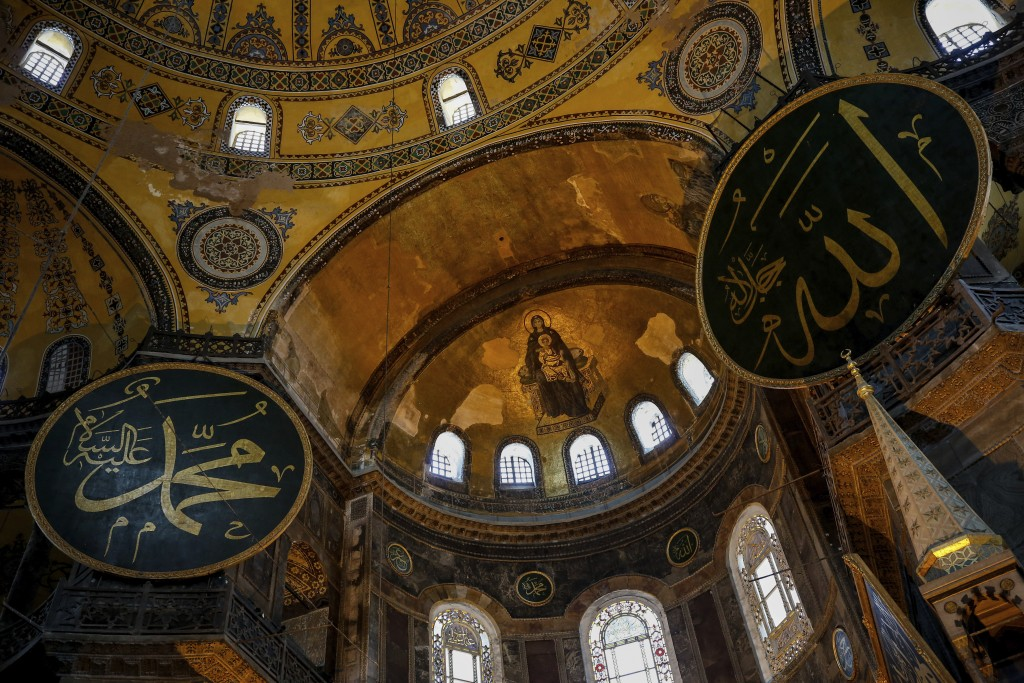 A view of the Byzantine-era Hagia Sophia, one of Istanbul's main tourist attractions in the historic Sultanahmet district of Istanbul, Thursday, June 25, 2020. The 6th-century building is now at the center of a heated debate between conservative groups who want it to be reconverted into a mosque and those who believe the World Heritage site should remain a museum. (AP Photo/Emrah Gurel)