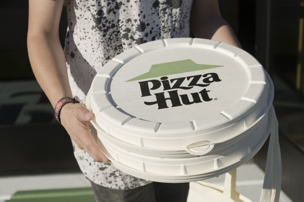 IMAGE DISTRIBUTED FOR PIZZA HUT - Pizza Hut is testing a round box and plant-based topping at one store in Phoenix at 3602 E Thomas Rd, on Wednesday, October 23, 2019. The round box is one of the most innovative pizza packaging designs on the market. This is the customers first opportunity to try Incogmeato a plant-based Italian sausage topping that comes on the new Garden Specialty Pizza. (Mark Peterman/AP Images for Pizza Hut)