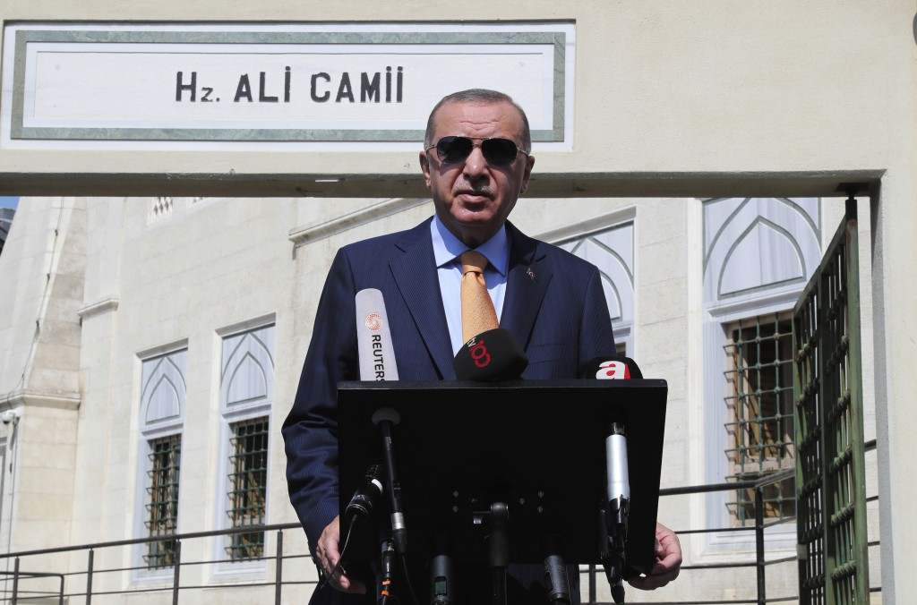 Turkey's President Recep Tayyip Erdogan talks to the media following Friday prayers at a mosque in Istanbul, Friday, Sept. 18, 2020. Turkey triggered a naval standoff with NATO ally Greece after dispatching another warship-escorted vessel in a part of the eastern Mediterranean that Greece says is over its continental shelf. Erdogan said the survey vessel, Oruc Reis, was withdrawn from Greek-claimed waters to give diplomacy a chance. (Turkish Presidency via AP, Pool)