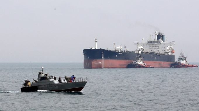 epa05844552 A military boat patrols next to the Artavil oil tanker, at the Kharg Island, in Persian Gulf, southern Iran, 12 March 2017. According to estimates, Kharg oil terminal handles 98 percent of Iran's crude exports.  EPA/ABEDIN TAHERKENAREH