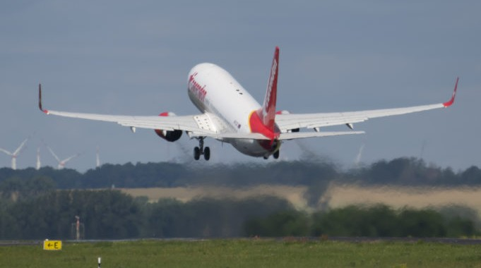 The plane takes off during the first holiday flight of the Corendon Airlines Europe to the Greek destination Rhodos at the airport Erfurt-Weimar in Erfurt, Germany, Thursday, July 2, 2020. The tourist air traffic was interrupted for several months due to the corona pandemic. (AP Photo/Jens Meyer)