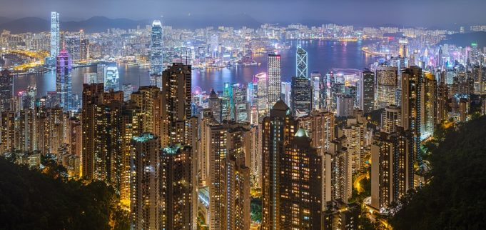Hong Kong harbour and skyline, seen from Victoria Peak on a rainy night of June 2019.