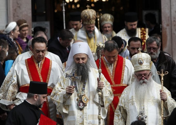 The new head of the Serbian Orthodox Church, Patriarch Porfirije, centre, greets believers after the Liturgy ceremony in Belgrade's Congregational church, Serbia, Friday, Feb. 19, 2021. Patriarch Porfirije replaces Patriarch Irinej, who died in November 2020 from COVID-19 complications. (AP Photo/Darko Vojinovic)
