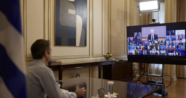 Greece's Prime Minister Kyriakos Mitsotakis speaks with EU leaders during an EU summit, via videoconference , from his office in Athens, Thursday, Feb. 26, 2021 (Dimitris Papamitsos/Greek Prime Minister's Office)