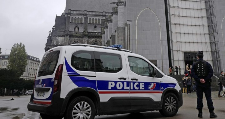 French police officers stand guard outside Notre Dame church in Lille, northern France, Sunday, Nov. 1, 2020. France heightened its security alert amid religious and geopolitical tensions around cartoons mocking the Muslim prophet. (AP Photo/Michel Spingler)
